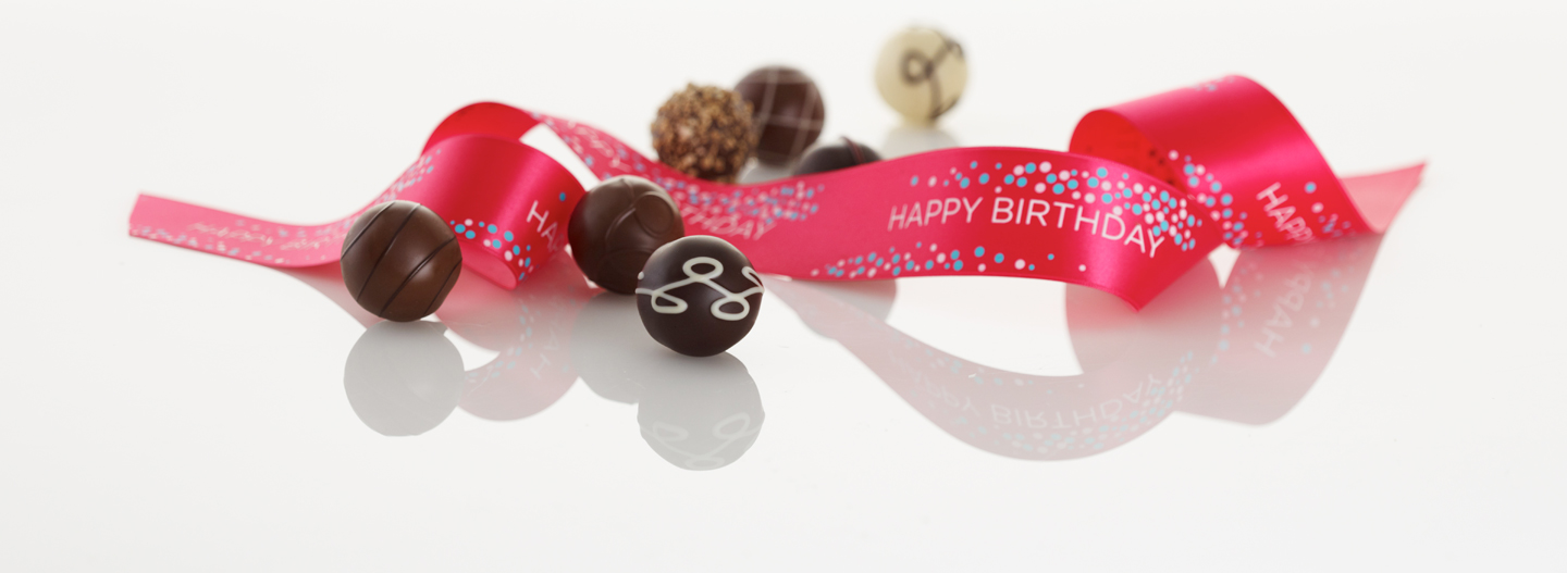 "Say ""Happy Birthday!"" GODIVA Ballotins, Baskets, and Truffles adorned with festive ribbon - the perfect gift."