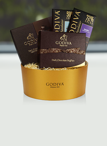 Dark chocolate gift boxes in basket