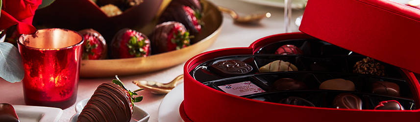 Open Satin Heart Gift Box alongside a plate of chocolate covered strawberries