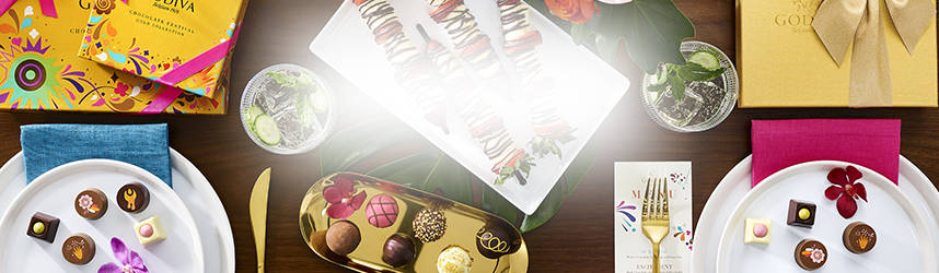 Festival gift boxes, chocolate strawberry kebobs, gold gift box, plates of chocolate pieces