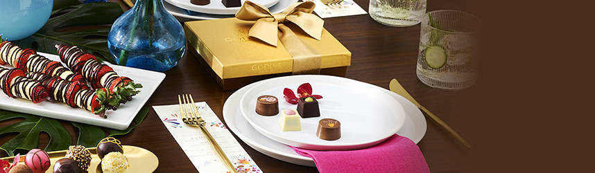 Gold gift box, plate of truffles, plate of limited edition pieces, strawberry kabobs