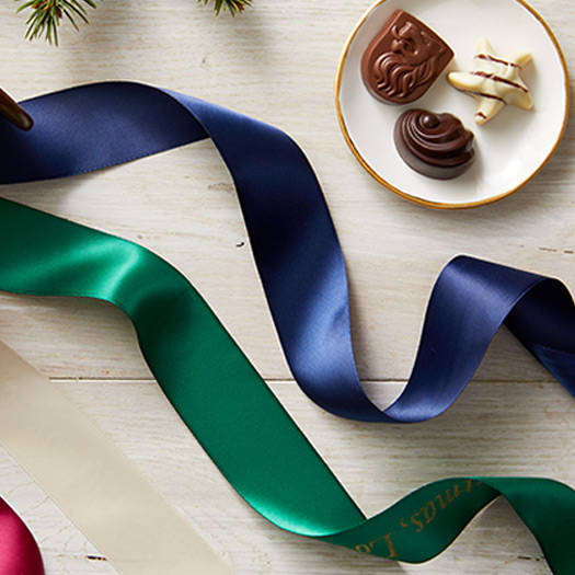 Holiday personalized ribbons on top of chocolate box