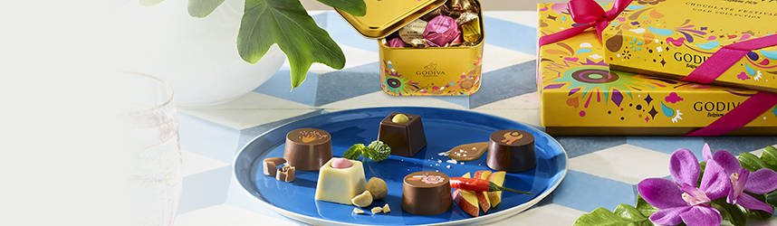 Festival gift boxes, next to plate of chocolates
